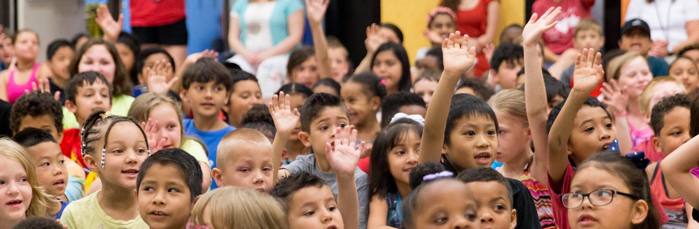Jackson Elementary School Students raising hands